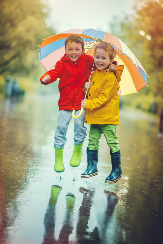 Little boys happily playing in the rain while on their Myrtle Beach Vacation at Plantation Resort!