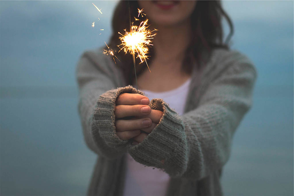 girl-in-sweater-with-sparkler