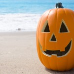 Halloween pumpkin on the beach