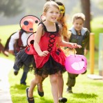 Children In Fancy Costume Dress Going Trick Or Treating Running