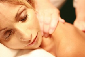 A woman enjoying a relaxing massage while on vacation at Plantation Resort Mother Earth Day Spa
